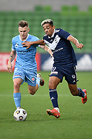 6th June 2021; AAMI Park, Melbourne, Victoria, Australia; A League Football, Melbourne Victory versus Melbourne City; Scott Galloway of Melbourne City and Ben Folami of the Victory chase after the through ball