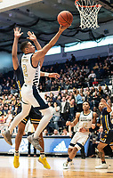 WASHINGTON, DC - FEBRUARY 22: Armel Potter #2 of George Washington lobs in a shot past Scott Spencer #2 of La Salle during a game between La Salle and George Washington at Charles E Smith Center on February 22, 2020 in Washington, DC.