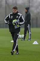 SWANSEA, WALES - APRIL 15: Swansea Assistant Manager Josep Clotet helps out during the Swansea City training session at the Fairwood Training Centre on April 15, 2015 in Swansea, Wales.  (photo by Athena Pictures)