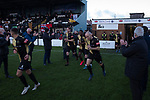 Marine 1 Hyde United 0, 12/12/2020. Marine Travel Arena, FA Trophy First Round. The home club's officials applauding their team on to the pitch before Marine play Hyde United in an FA Trophy first round tie at the Marine Travel Arena, formerly known as Rossett Park, in Crosby. Due to coronavirus regulations which had suspended league games, the Merseysiders' only fixtures were in cup competitions, including their forthcoming tie against Tottenham Hotspur in the FA Cup third round. Marine won the game by 1-0, watched by a permitted capacity of 400, with the visitors having two men sent off in the second half. Photo by Colin McPherson.