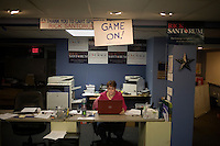 A staffer sits at the reception desk at the Rick Santorum New Hampshire campaign headquarters in Bedford, New Hampshire, on Jan. 7, 2012.  Santorum is seeking the 2012 Republican presidential nomination.