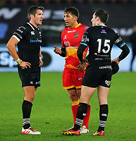 Gavin Henson of the Dragons (C) speaks with James Hook (L) and Sam Davies of the Ospreys (R) during the Guinness PRO14 match between Ospreys and Dragons at The Liberty Stadium, Swansea, Wales, UK. Friday 27 October 2017