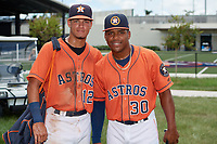 GCL Astros Carlos Diaz (12) and Gerry Castillo (30) pose for a photo after a game against the GCL Marlins on August 5, 2018 at FITTEAM Ballpark of the Palm Beaches in West Palm Beach, Florida.  GCL Astros defeated GCL Marlins 2-1.  (Mike Janes/Four Seam Images)