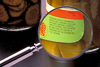 What's in a jar of pickles; reading food labels, close-up magnifying glass, chemicals, additives, ingredients, health.