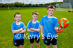 Firies U9's Dermot Keane, Jack Cooper and Adam Quirke training at the Firies GAA grounds on Saturday morning.