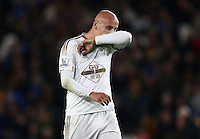 Jonjo Shelvey of Swansea City looks dejected during the Capital One Cup match between Hull City and Swansea City played at the Kingston Communications Stadium, Hull