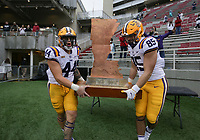 LSU players carry The Boot, Saturday, November 21, 2020 at the end of a football game at Donald W. Reynolds Razorback Stadium in Fayetteville. Check out nwaonline.com/201122Daily/ for today's photo gallery. <br /> (NWA Democrat-Gazette/Charlie Kaijo)