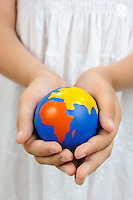 Girl (10) holding Earth Globe in cupped hands (Licence this image exclusively with Getty: http://www.gettyimages.com/detail/102966070 )