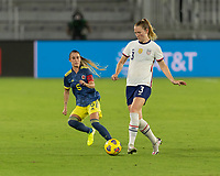 ORLANDO, FL - JANUARY 22: Sam Mewis #3 passes the ball away from Daniela Montoya #6 during a game between Colombia and USWNT at Exploria stadium on January 22, 2021 in Orlando, Florida.