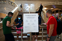 NEW YORK , NY JUNE 16: People visit grand central station the next day as the city mark the end of the COVID-19 restrictions in  New York on June 17 2021. <br /> (Photo by Kena Betancur/VIEWpress)