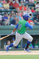 Right fielder Elier Hernandez (12) of the Lexington Legends bats in a game against the Greenville Drive on Friday, August 29, 2014, at Fluor Field at the West End in Greenville, South Carolina. Hernandez is the No. 11 prospect of the KansasCity Royals, according to Baseball America. Greenville won, 6-1. (Tom Priddy/Four Seam Images)