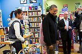 "United States President Barack Obama, center, and daughter Malia, left, shop at One More Page Books in Arlington, Virginia on Small Business Saturday, November 24, 2012..Credit: Kristoffer Tripplaar  / Pool via CNP..Pool Report 1: Motorcade left the South Lawn [of the White House] at 1:02 p.m. and arrived in Arlington, Virginia, at One More Page Books at 1:15 p.m. for an OTR (Off the Record) Small Business Saturday event with Sasha and Malia.  From the door of the small book shop, which the White House described as an ""independent, neighborhood bookstore,"" POTUS (President of the United States) could be seen holding up his BlackBerry, apparently looking up a title, as he spoke with shop owner Eileen McGervey. ""Preparation,"" the president said. ""That's how I shop.""  Wearing a dark windbreaker against the blustery weather outside, POTUS handed off a stack of about 10 books to the clerk -- pool was too far away to read titles -- (will send in a later report if we get them) and then shook hands with several employees. He then began to wander through the business with his daughters as pool was escorted out.  ""We're doing Christmas shopping,"" POTUS said to a question from the pool about the fiscal cliff. ""Happy Thanksgiving, folks.""  POTUS emerged about 10 minutes later to shake hands for a few minutes with two small groups that formed outside the shop on the sidewalk."