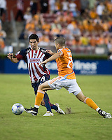 Houston Dynamo defender defender Wade Barrett (24) clears the ball from  CD Guadalajara defender Jonny Magallon (19).  CD Guadalajara defeated Houston Dynamo 1-0 during the group stage of the Superliga 2008 tournament at Robertson Stadium in Houston, TX on July 15, 2008.