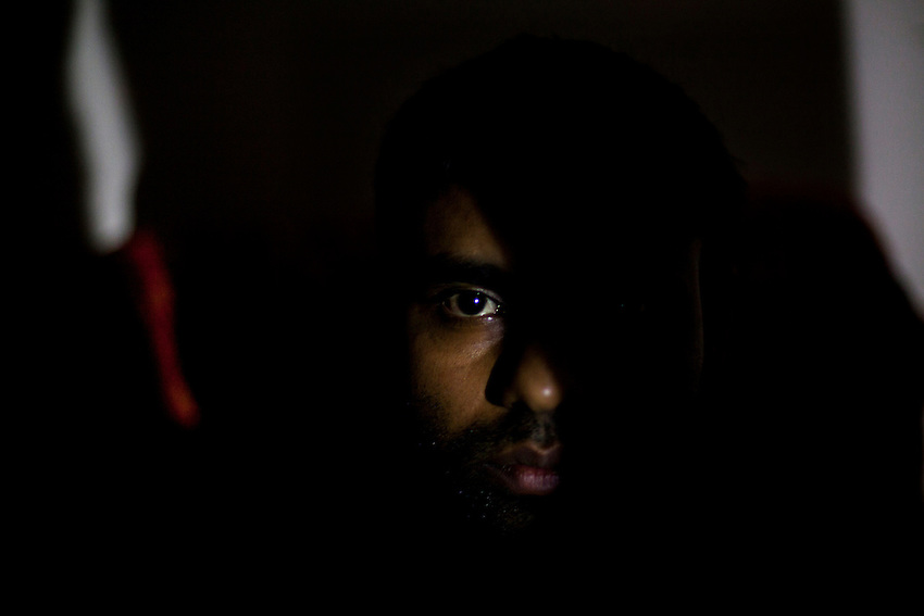 """YG (pseudonym), an ethnic Tamil who is a survivor of torture at the hands of Sri Lankan security forces, poses for a photograph in London, the United Kingdom, October 16, 2012. YG has significant scarring on his back from beatings and when he was burned by Sri Lankan security authorities. He also has scarring from cigarette burns on his chest. He is currently seeking asylum status in the United Kingdom. """"I helped the LTTE when I was studying. When I was working in Vavuniya I was arrested on suspicion of being an LTTE member. I was detained for seven days and I was tortured badly during the detention. I was released on bail. I was scared to live in Vavuniya, so my family arranged for me to leave to Canada (with the help of an agent). On my way to Canada I was arrested in one of the African countries, and I was deported from there. When I landed in the (Colombo) airport I was detained at the airport by CID. I was taken to detention and detained for two months and I was tortured very badly. I was burned with cigarette butts, and I was beaten...with batons electrical wires. I was hung upside down with both of my hands tied together and I was beaten.  They used a petrol (soaked) bag to cover my face and I was suffocated. My uncle helped me to get out from the detention. He paid a bribe and I was allowed to escape from the detention. Then I went to the Vanni, to an LTTE-controlled area. While in the Vanni, I was forcibly recruited by the LTTE in 2008. I escaped from the LTTE and then I went to Vavuniya and then to Colombo. With the help of an agent, I came to the UK in the later part of 2010."""" YG's asylum case is still pending."""