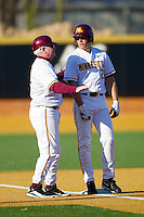 Minnesota Golden Gophers head coach John Anderson talks with David Bettenburg #2 at third base during the game against the Towson Tigers at Gene Hooks Field on February 26, 2011 in Winston-Salem, North Carolina.  The Gophers defeated the Tigers 6-4.  Photo by Brian Westerholt / Sports On Film