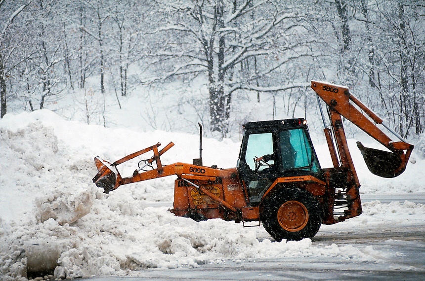 Clearing snow from lot.
