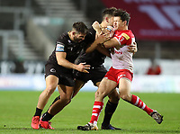 20th November 2020; Totally Wicked Stadium, Saint Helens, Merseyside, England; BetFred Super League Playoff Rugby, Saint Helens Saints v Catalan Dragons; Jason Baitieri and Mickael Simon of Catalan Dragons tackle Lachlan Coote of St Helens