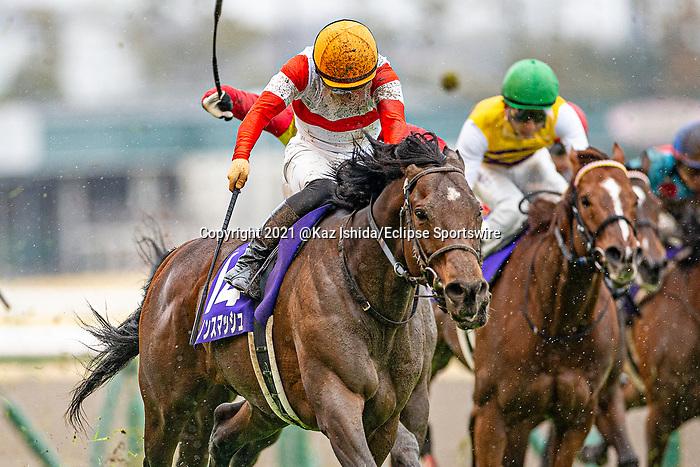 TOYOAKE,JAPAN-MAR 28: Danon Smash,ridden by Yuga Kawada,wins the Takamatsunomiya Kinen at Chukyo Racecourse on March 28,2021 in Toyoake,Aichi,Japan. Kaz Ishida/Eclipse Sportswire/CSM