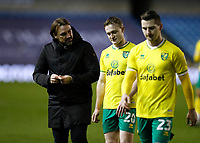 2nd February 2021; The Den, Bermondsey, London, England; English Championship Football, Millwall Football Club versus Norwich City; Norwich City Manager Daniel Farke talking to Oliver Skipp of Norwich City while the pair walk off the pitch towards the away tunnel after the final whistle