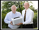 07/07/2010   Copyright  Pic : James Stewart.002_big_fish_printer  .::  GORDON BENNIE, MD OF BIG FISH, PRESENTS A PRINTER TO KEN MONCRIEFF OF THE INFINITE GROUP WHICH THEY WON IN A PRIZE DRAW AT THE RECENT FALKIRK BUSINESS FAIR ::
