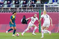 KASHIMA, JAPAN - JULY 27: Sam Kerr #2 of Australia and Tierna Davidson #12 and Sam Mewis #3 of the United States battle for the ball during a game between Australia and USWNT at Ibaraki Kashima Stadium on July 27, 2021 in Kashima, Japan.
