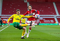 Norwich City's Jacob Lungi Sorensen clears under pressure from Middlesbrough's Jonathan Howson<br /> <br /> Photographer Alex Dodd/CameraSport<br /> <br /> The EFL Sky Bet Championship - Middlesbrough v Norwich City - Saturday 21st November 2020 - Riverside Stadium - Middlesbrough<br /> <br /> World Copyright © 2020 CameraSport. All rights reserved. 43 Linden Ave. Countesthorpe. Leicester. England. LE8 5PG - Tel: +44 (0) 116 277 4147 - admin@camerasport.com - www.camerasport.com