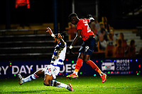 21st April 2021; Kenilworth Road, Luton, Bedfordshire, England; English Football League Championship Football, Luton Town versus Reading; Elijah Adebayo of Luton Town with an effort on goal as Moore of Reading challenges