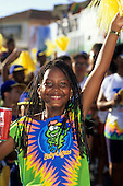 Salvador, Bahia State, Brazil; girl with braided hair in carnival costume holding a can of Coca-Cola - Baby Leguas.