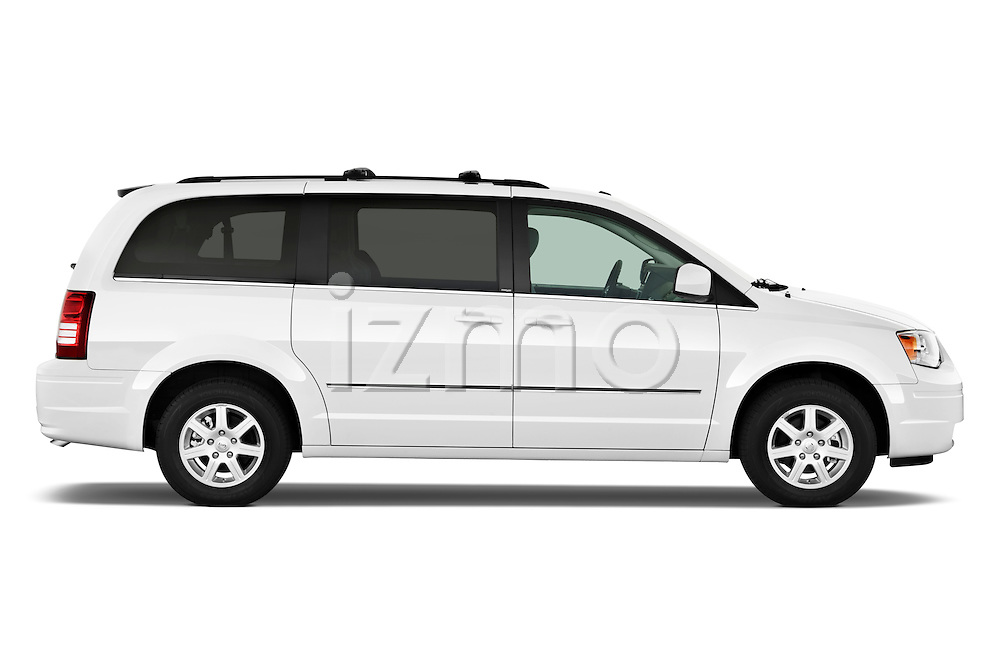 Passenger side profile view of a 2010 Chrysler Town and Country Touring.