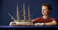 BNPS.co.uk (01202) 558833. <br /> Pic: CorinMesser/BNPS<br /> <br /> Pictured: Hannah Farthing of Woolley and Wallis with the ship. <br /> <br /> A model ship exquisitely carved out of animal bone by a French Prisoner of War during the Napoleonic Wars is expected to sell for £6,000.<br /> <br /> The 48-gun Royal Navy frigate was fashioned by a French PoW locked in Portchester Castle, Hants, over 200 years ago, using animal bones left over from rations. <br /> <br /> The medieval fortress became a jail for over 7,000 French prisoners during the Napoleonic Wars, which lasted from 1793 to 1815.<br /> <br /> Many used their endless hours locked away to craft beautifully detailed ships which were sold at market.