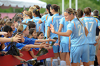 Laura Kalmari (21) of Sky Blue FC greets fans as the team is about to take the field. FC Gold Pride defeated Sky Blue FC 1-0 during a Women's Professional Soccer (WPS) match at Yurcak Field in Piscataway, NJ, on May 1, 2010.