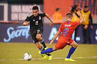 EAST RUTHERFORD, NJ - SEPTEMBER 7: Carlos Rodriguez #8 of Mexico battles for the ball with Wil Trapp #6 of the United States during a game between Mexico and USMNT at MetLife Stadium on September 6, 2019 in East Rutherford, New Jersey.