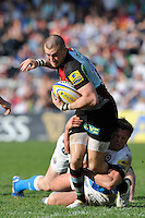 Mike Brown of Harlequins is tackled by Michael Claassens of Bath Rugby during the Aviva Premiership match between Harlequins and Bath Rugby at The Twickenham Stoop on Saturday 24th March 2012 (Photo by Rob Munro)