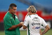 Santos Laguna physical trainer Luis Carlos Bongiovanni D´avola talks with forward Vicente Matias Vuoso (30) prior to the match. The New England Revolution defeated Santos Laguna 1-0 during a Group B match of the 2008 North American SuperLiga at Gillette Stadium in Foxborough, Massachusetts, on July 13, 2008.