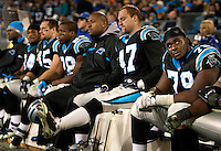 Carolina Panthers sit on the bench while loosing to the Arizona Cardinals during the NFC Divisional Playoff football game at Bank of America Stadium, in Charlotte, NC. Arizona defeated the Carolina Panthers 33-13.