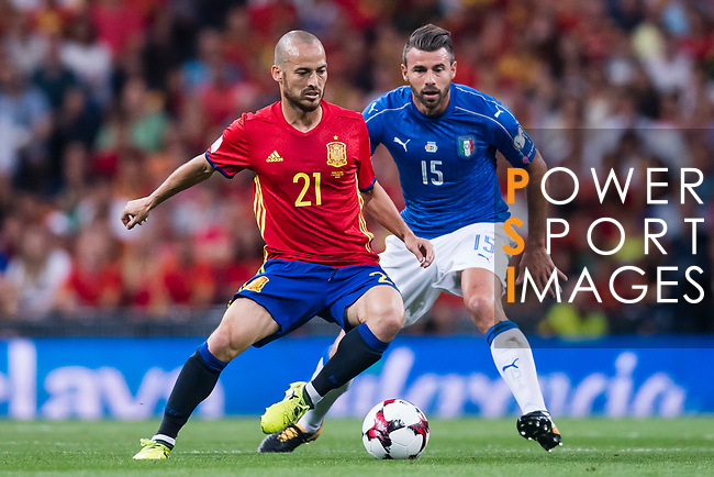 David Silva (L) of Spain fights for the ball with Andrea Barzagli (R) of Italy during their 2018 FIFA World Cup Russia Final Qualification Round 1 Group G match between Spain and Italy on 02 September 2017, at Santiago Bernabeu Stadium, in Madrid, Spain. Photo by Diego Gonzalez / Power Sport Images
