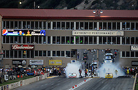 Jul, 20, 2012; Morrison, CO, USA: NHRA pro stock driver Mike Edwards (left) burns out alongside Jeg Coughlin during qualifying for the Mile High Nationals at Bandimere Speedway. Mandatory Credit: Mark J. Rebilas-