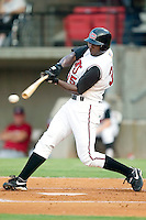 Carolina Mudcats outfielder Frank Moore (35) breaks his bat as he makes contact versus the Huntsville Stars at Five County Stadium in Zebulon, NC, Thursday, July 20, 2006.