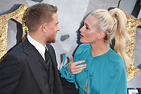 """Charlie Hunnam and Poppy Delevingne<br /> at the premiere of """"King Arthur:Legend of the Sword"""" at the Empire Leicester Square, London. <br /> <br /> <br /> ©Ash Knotek  D3265  10/05/2017"""