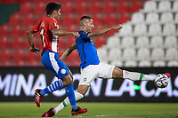 8th June 2021; Defensores del Chaco Stadium, Asuncion, Paraguay; World Cup football 2022 qualifiers; Paraguay versus Brazil;   Robert Rojas of Paraguay as Richarlison of Brazil stretches for the cross
