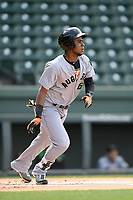 Shortstop Manuel Geraldo (26) of the Augusta GreenJackets bats in a game against the Greenville Drive on Wednesday, April 25, 2018, at Fluor Field at the West End in Greenville, South Carolina. Augusta won, 9-2. (Tom Priddy/Four Seam Images)