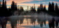 Sunrise relection with trees on Reflection Lake. Mt. Rainier National Park, Washington