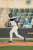 Mylz Jones (7) of the Asheville Tourists follows through on his swing against the Kannapolis Intimidators at Kannapolis Intimidators Stadium on May 27, 2016 in Kannapolis, North Carolina.  The Tourists defeated the Intimidators 7-6.  (Brian Westerholt/Four Seam Images)