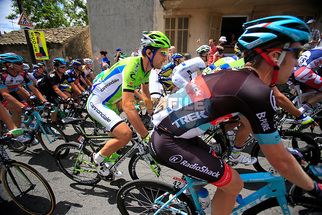 The peleton pass through the village of Biot during Stage 5 of the 100th Edition of the Tour de France 2013 from Cagnes-Sur-Mer to Marseille. 3rd July 2013.<br /> (Photo: Eoin Clarke/ www.newsfile.ie)
