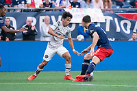 FOXBOROUGH, MA - JULY 25: Matt Polster #8 of New England Revolution comes in to tackle Joaquín Torres #18 of CF Montreal during a game between CF Montreal and New England Revolution at Gillette Stadium on July 25, 2021 in Foxborough, Massachusetts.