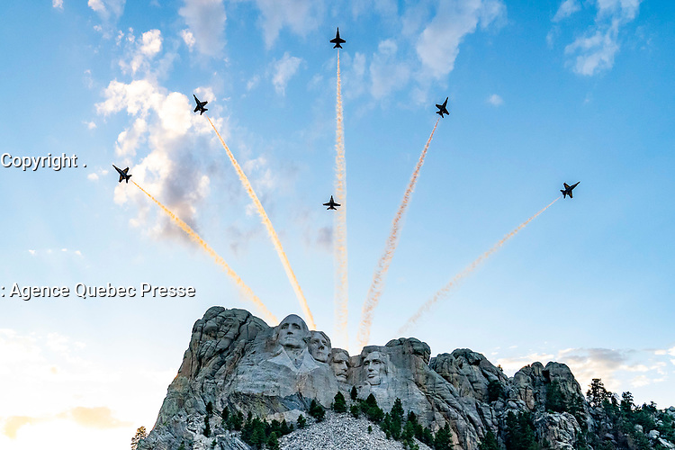 Mount Rushmore Fireworks Celebration<br /> <br /> President Donald J. Trump and First Lady Melania Trump watch an aerial review of aircraft Friday, July 3, 2020, during South Dakota's 2020 Mount Rushmore Fireworks Celebration at the Mount Rushmore National Memorial in Keystone, S.D. (Official White House Photo by Tia Dufour)