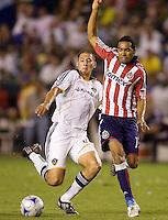 LA Galaxy defender Omar Gonzalez defending aganst Chivas USA forward Maykel Galindo. The LA Galaxy defeated Chivas USA 1-0 to win the final edition of the 2009 SuperClásico at Home Depot Center stadium in Carson, California on Saturday, August 29, 2009...