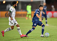 LAKE BUENA VISTA, FL - AUGUST 01: Jesús Medina #19 of New York City FC dribbles away from Eryk Williamson #30 of the Portland Timbers during a game between Portland Timbers and New York City FC at ESPN Wide World of Sports on August 01, 2020 in Lake Buena Vista, Florida.