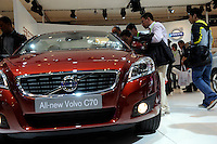 Chinese men look at Volvo C70 at the Beijing Auto Show. The car show has attracted all the world's major auto markers. China's vehicle sales have breached the 10-million barrier for the first time ever, with 10.9 million automobiles sold last year. .24 Apr 2010