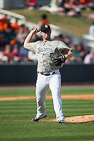 Birmingham Barons relief pitcher Tyler Barnette (44) makes a throw to first base against the Tennessee Smokies at Regions Field on May 3, 2015 in Birmingham, Alabama.  The Smokies defeated the Barons 3-0.  (Brian Westerholt/Four Seam Images)